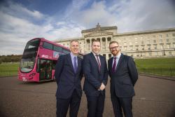 Infrastructure Minister Chris Hazzard with Finance Minister Máirtín Ó Muilleoir and Economy Minister Simon Hamilton