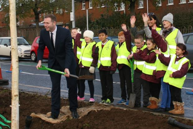 Minister joins St Mary's Primary School pupils to plant trees on Divis Street