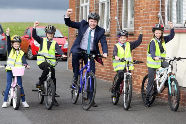 Minister Hazzard celebrates Bike to School Day with pupils from St Colmcille's Primary School