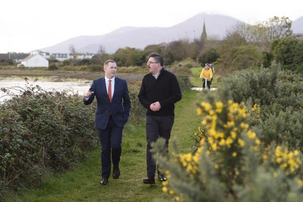 Infrastructure Minister Chris Hazzard and Jonathan Hobbs from NI Greenways enjoy a walk along the old railway track near Dundrum