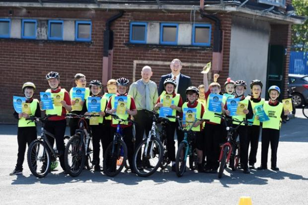 Infrastructure Minister visits Holy Cross Boys Primary School